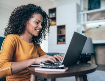 young woman on laptop sitting at desk